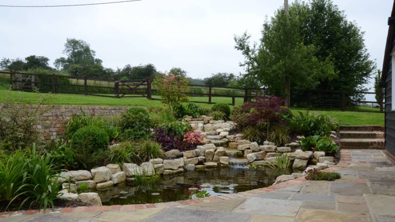 Stunning planting scheme, pond, rockery and patio