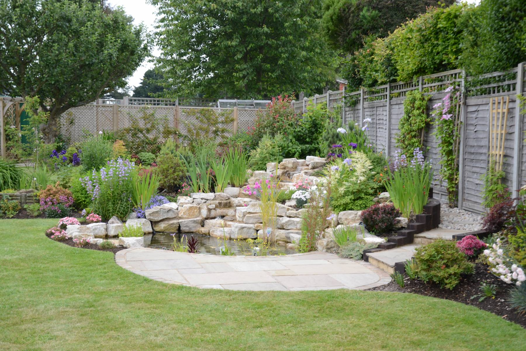 Pond, rockery and planting scheme