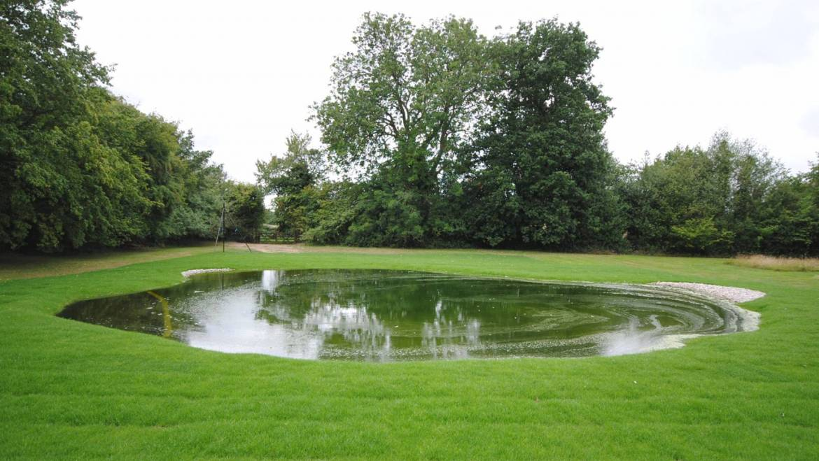 Converting a tennis court into a Natural Pond