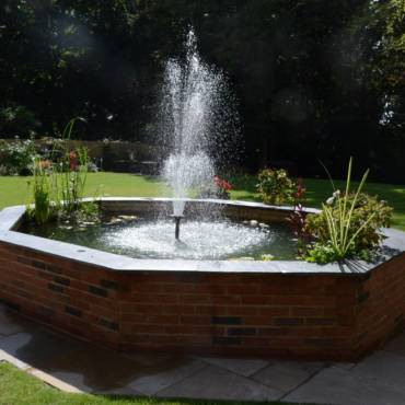 Raised Brick Pond and Patio Landscape Garden Design