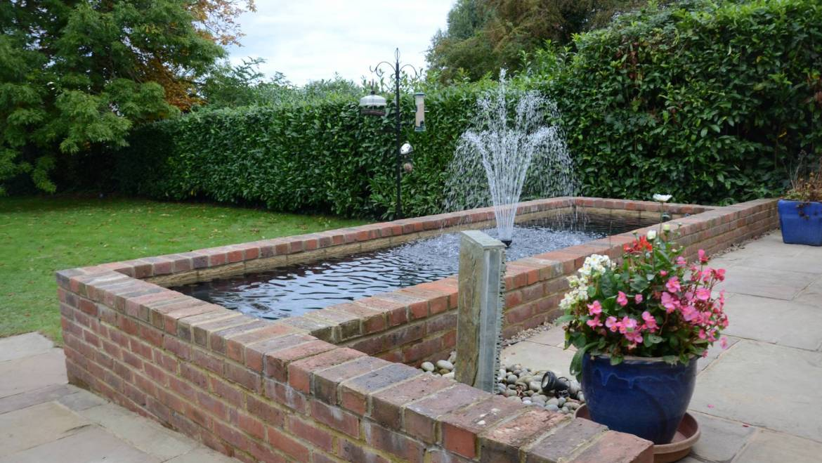 A raised brickwork pond