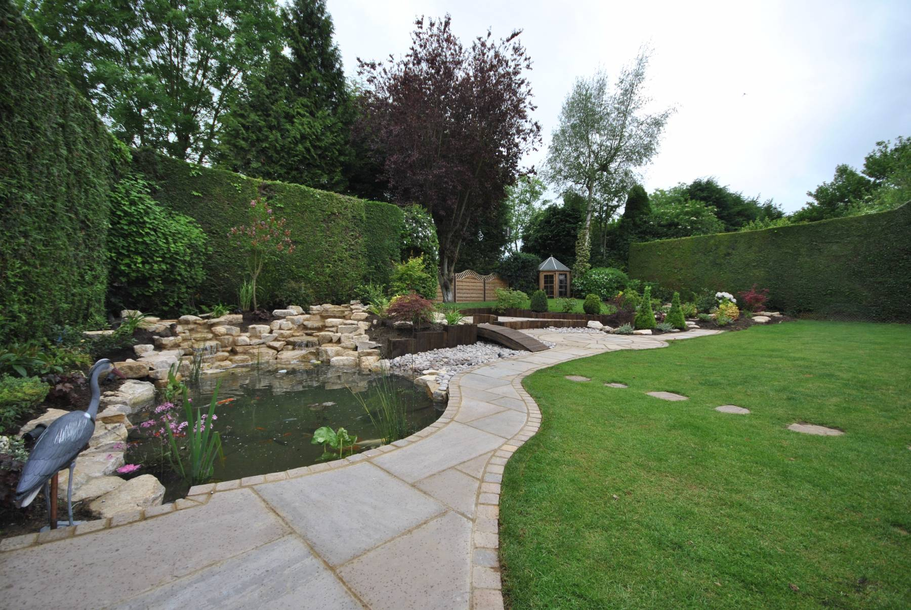 full garden landscape, pond, railway sleepers