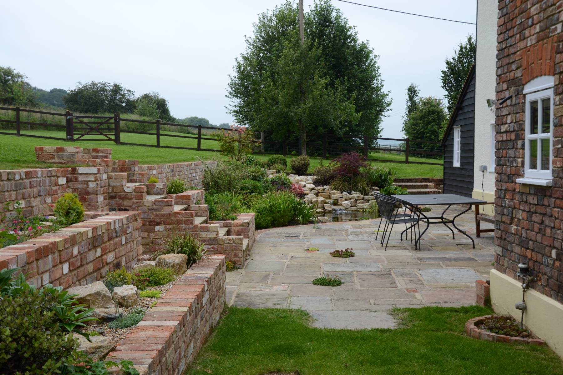 full garden landscape, patio, brickwork, ppond