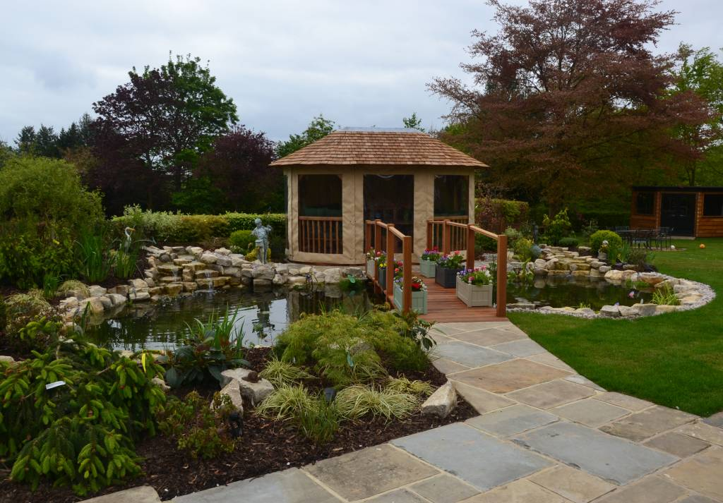 York patio seating area landscape timber decking pond rockery plant design garden design