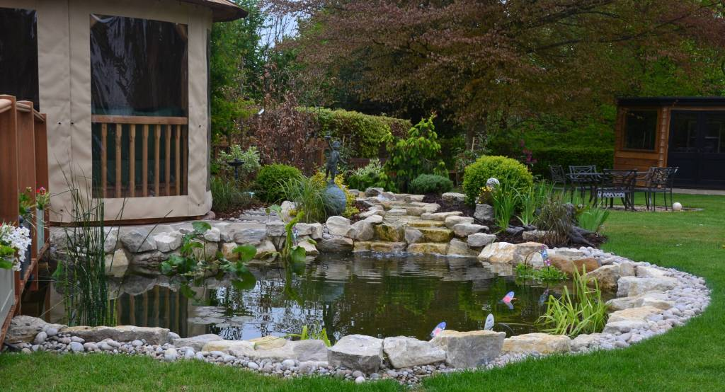 York patio seating area landscape timber decking pond rockery plant design garden design Crown Pavilion