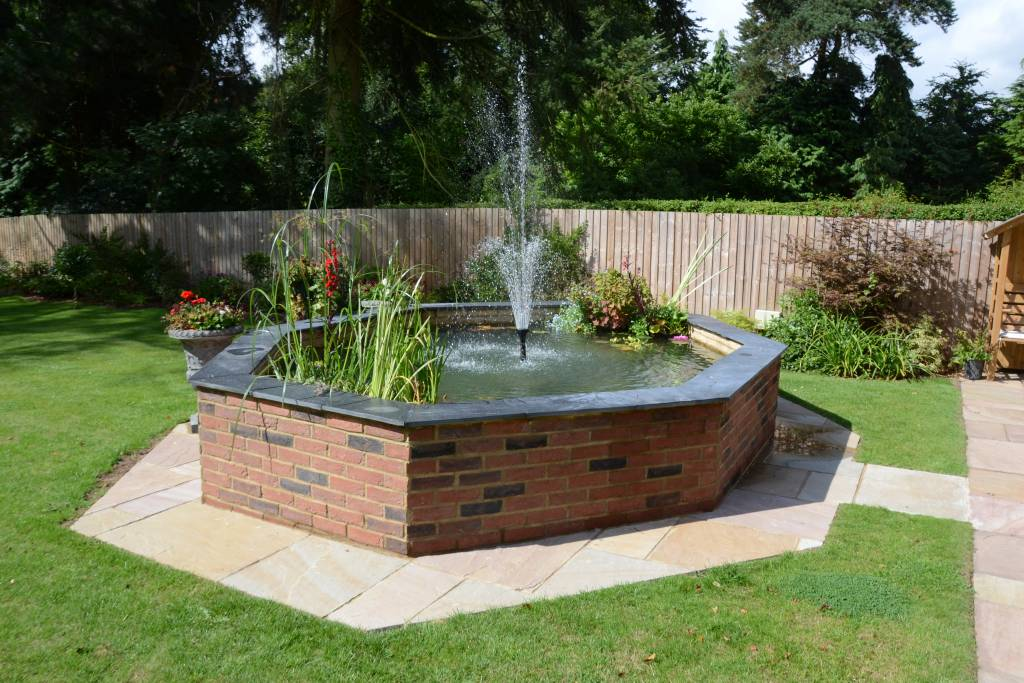 raised brick pond fountain coping